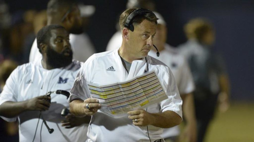 Blue Devils' head coach Richard Morgan looks on from the sidelines during a game at Marietta.